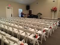 White Foldable Resin Chairs Rentals in the Victoria Texas area.