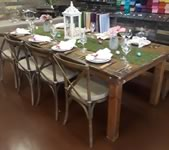 Farm Table with cross back chairs.