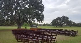 Mahogany Foldable Resin Chair Rentals in the Victoria Texas area.